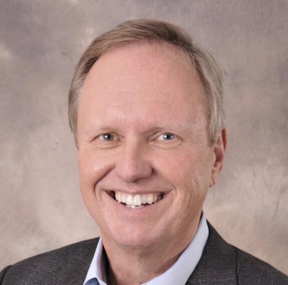headshot of Jeff E. Flocken